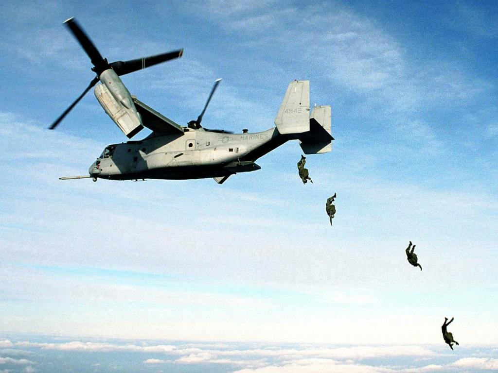 U.S. Marine Corps parachutists free fall<br />from an MV-22 Osprey at 10,000 feet wallpaper