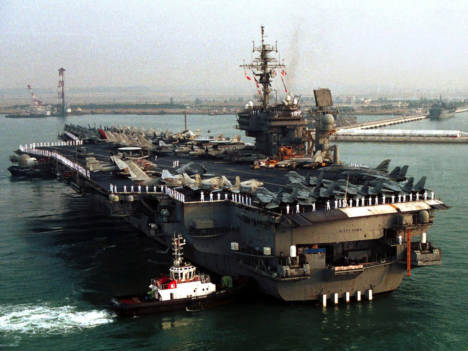 USS Kitty Hawk in Singapore Harbor wallpaper