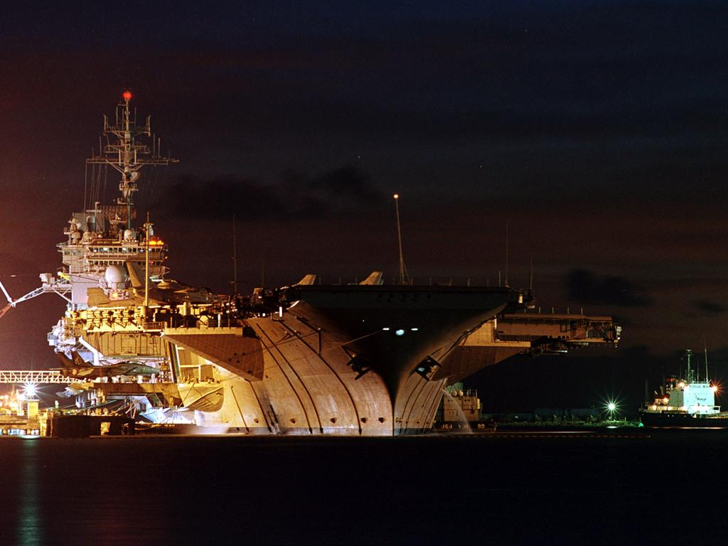USS Kitty Hawk at night wallpaper